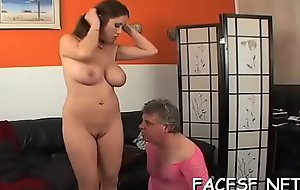 Big titted chick humiliates coupled with smothers an older lady's man
